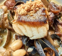 Spiced hake with roast artichokes